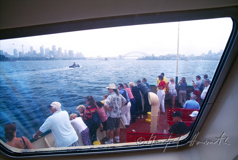 passenger ferry passes the Sydney Opera House