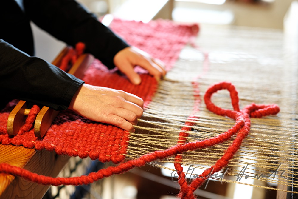 Manfred Horvath Barbara Schmidt weaves a wool carpet in